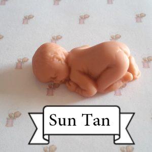 bébé couché sun tan