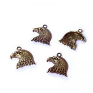 Lot 10 breloques pendentifs tête aigle bronze ocre