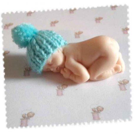 mini bonnet turquoise avec pompom